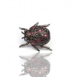 Broche de oro negro y oro rosa con zafiros negros y rubis
