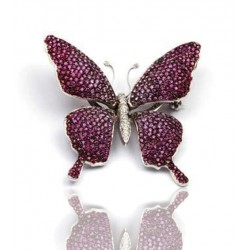 Broche oro blanco con diamantes y zafiros rosas
